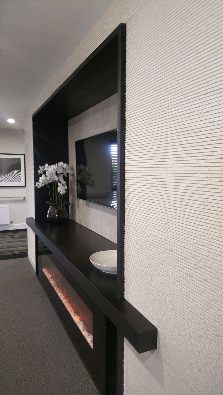 88 best 3d decorative wall panels images on pinterest external modern white textured stonini wall panels featured around a fireplace transforming any interior or exterior amipublicfo Gallery