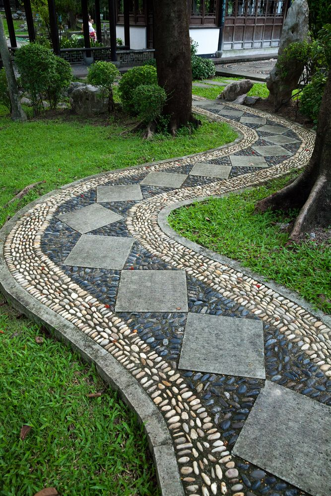 Intricately designed stone walkway features white and