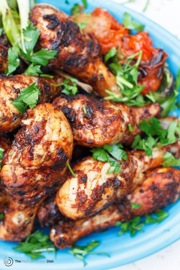 Grilled Chicken Drumsticks Recipe with Garlic Harissa Marinade | The Mediterranean Dish. This Moroccan-inspired chicken recipe will be your new go-to! Chicken drumsticks marinated in a spicy and zesty sauce of garlic, harissa paste, and Mediterranean spices with lime juice and olive oil. The result, succulent, flavor-packed grilled chicken that will please everyone! Get the easy step-by-step today!