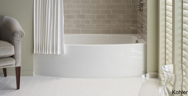 """Kohler's Expanse is another hot Kohler tub designed for small baths across the globe. The curved basin and integral apron add a sense of elegance to your bathroom. With its 60""""x30""""x17"""" dimensions, much like the Archer above, the Expanse tub lets you stretch out and forget your daily struggles as you wash away in your gentle, yet compact tub. While it's modern design lends itself to contemporary or modern homes, many designers have found ways to integrate these great soakers in more…"""