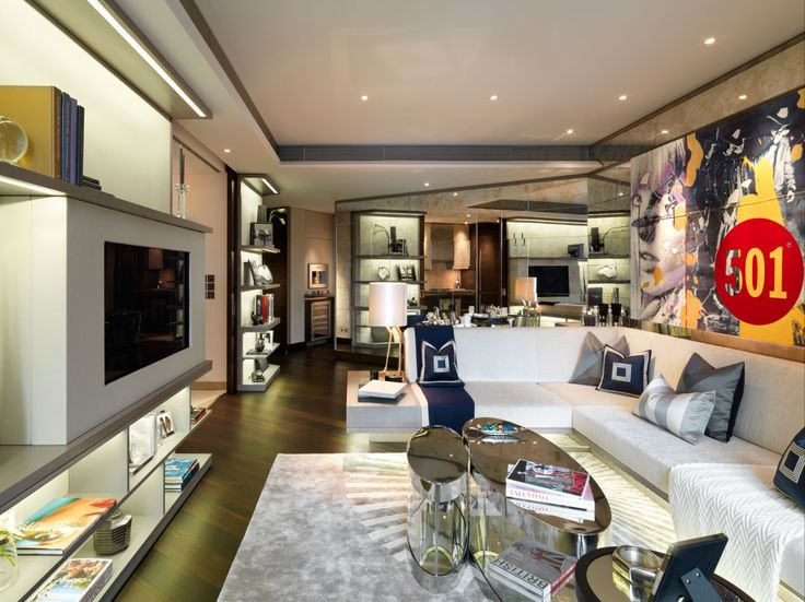 Project by CANDY AND CANDY| Funcional and modern living room with a mirror wall, perfect to look more bigger.|  www.bocadolobo.com #bocadolobo #luxuryfurniture #exclusivedesign #top100interiordesigners #top100 #interiordesign