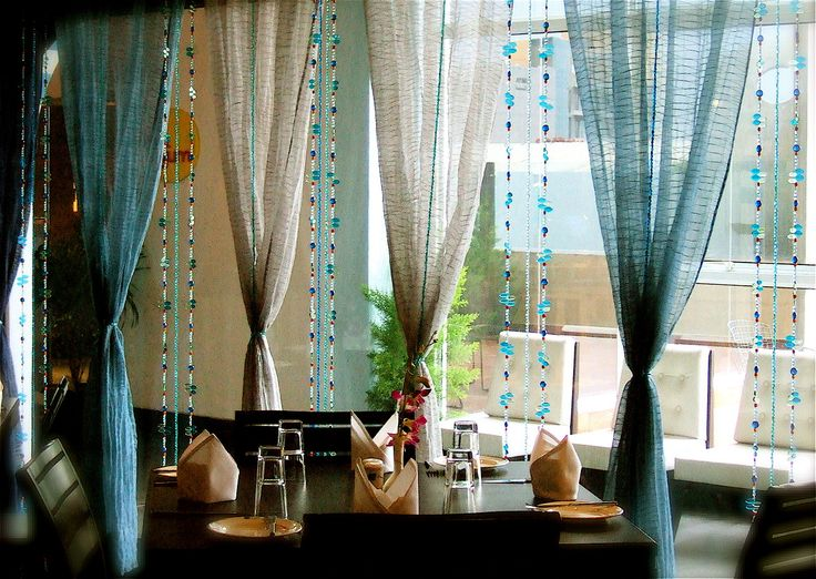 Lovely arrangement of bead curtains. Love the colors blue, ivory