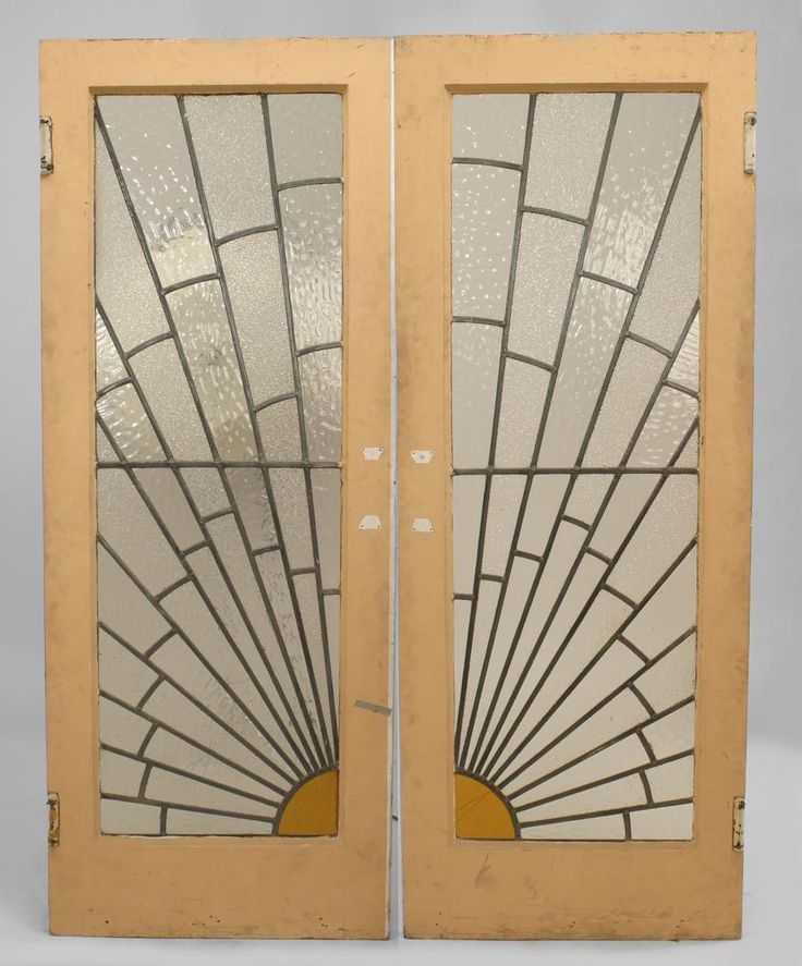 Pair of French Art Deco leaded glass doors with sunburst design and painted frame