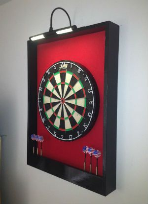 A luxury framed felt dartboard surround, perfect for a games room or man cave