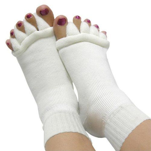 Foot alignment socks. N.A.H.C. http://www.amazon.com/dp/B002XN688A/ref=cm_sw_r_pi_dp_v.nOub0XWCB9V