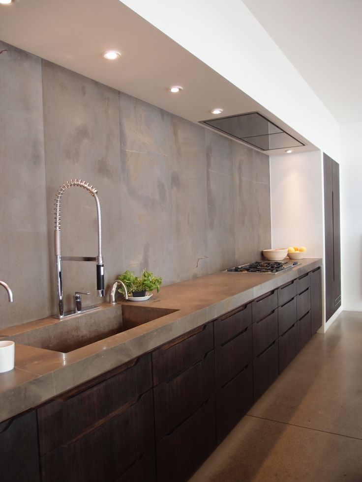 | P | Kitchen with concrete counters + backsplash
