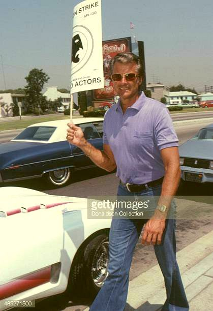 Lyle Waggoner holds a protest sign in Los Angeles, California. July, 1980.