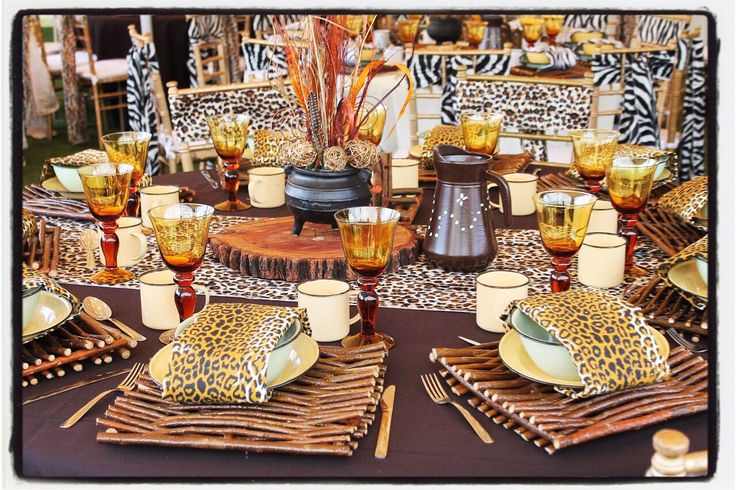 Traditional african wedding decor. Zulu wedding. Wedding ideas. Wedding centerpieces. Luxurious animal prints. Hand painted jugs. www.secundatents.com