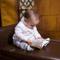 Remember to bring in special objects, such as a Rosary and a Bible, to add to their portraits | JCPenney Portraits