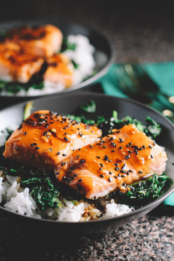 Asian Salmon and Spinach Rice Bowls (serves 4): •1 pound salmon, cute into 4 fillets  •2 cups jasmine rice  •4 tablespoons gluten-free soy sauce  •4 tablespoons pure maple syrup  •juice from one lime  •1.5 teaspoons cornstarch  •1 package 10 oz frozen spinach  •1 teaspoon minced garlic  •½ tablespoon olive oil  •½ teaspoon red pepper flakes  •1-2 tablespoons black sesame seeds