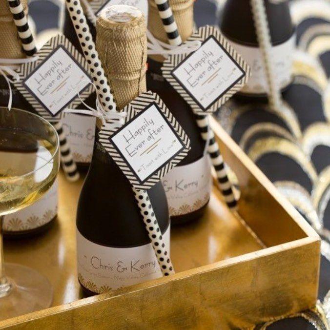 Couple labelled mini champagne bottles. #Bonbonnieres #WeddingFavour #MiniChampagne