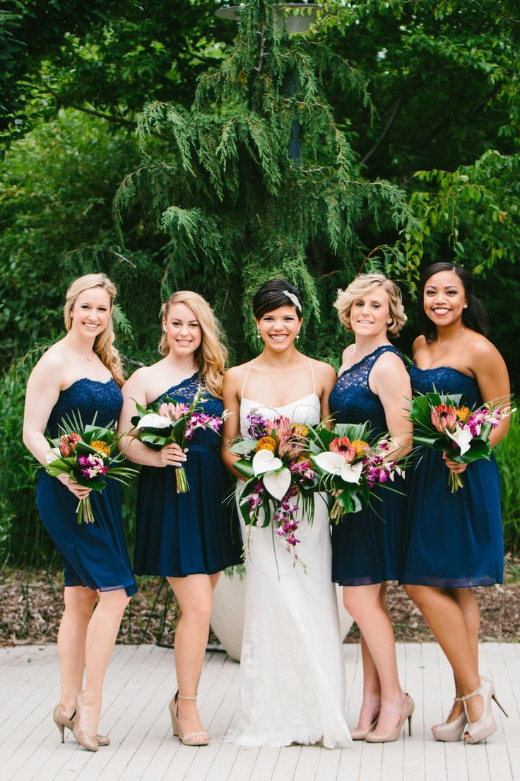 A botanical gardens wedding on a budget...and you'd never know - the venue, that dress and those absolutely breathtaking bouquets. You aren't going to want to miss this one!