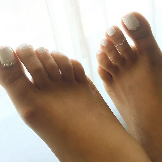 The white nail polish on toes doesn't even bother me.....I hate toenails that are rounded, curved and LONG!!!  I have beautiful toes and toenails....some people, not so much!