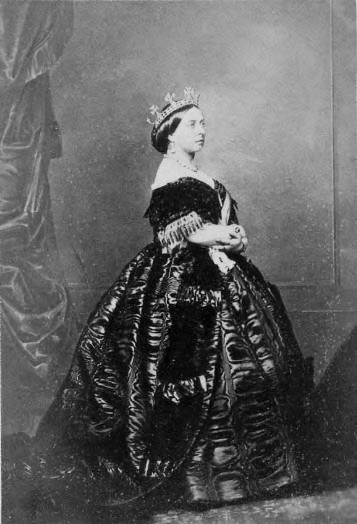 Queen Victoria, 1861. Prince Albert died that year but this was probably taken before that happened (he died in late December). Her dress here is quite magnificent - some kind of ruched silk perhaps, and in a dark colour but not necessarily black.