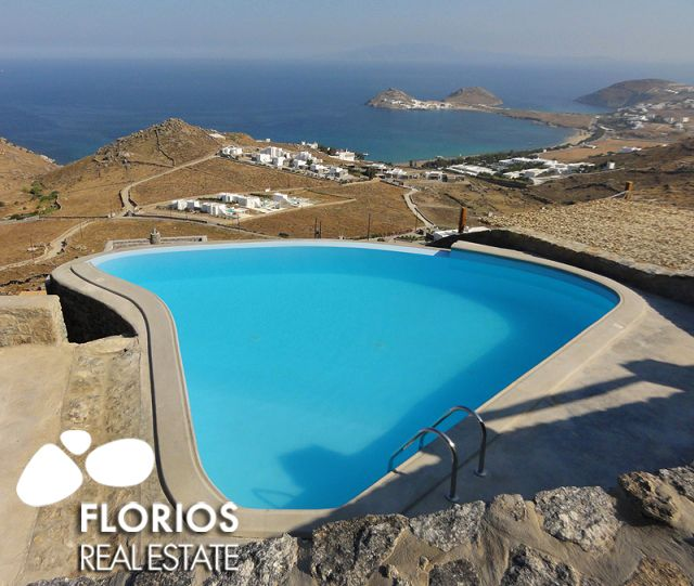 Relaxing on the sun beds by the pool one can enjoy the view over the twin cape marking the end of Kalafatis bay, or watch the surfers catching a summer breeze. FL1041 Villa for Sale on Mykonos island Greece. http://www.florios.gr/en/Villas-For-Sale-Mykonos-Island-Greece.html