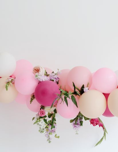 Balloons + floral backdrop
