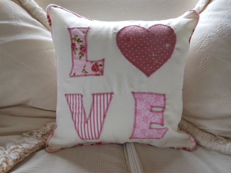 What the world needs...LOVE, this cushion says it all!  Available in a variety of colour combinations. Letters machine appliqued onto cushion.