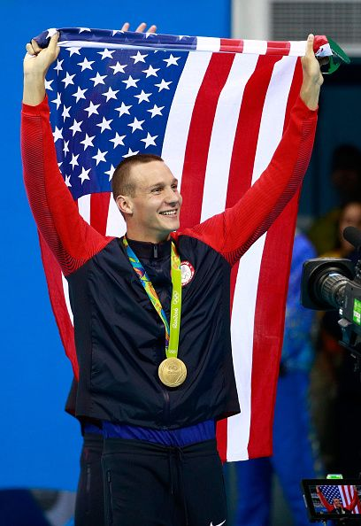 Gold medalists Caeleb Dressell of the United States celebrates during the medal ceremony for the Final of the Men's 4 x 100m Freestyle…