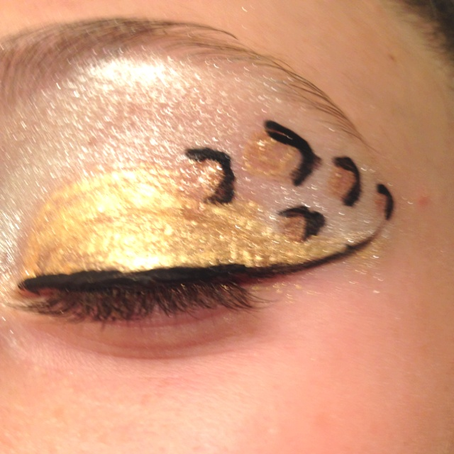 leopard print eye makeup #cheer #cheerleading This is such a good idea for Caribou!!!
