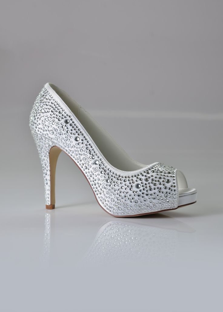 The name says it all! Fifi is an all-over bling R-shoe from Bride&co, perfect as a #wedding shoe or (really) special, special occasion heels. Available in black and white. Click to View More or Get the Price!