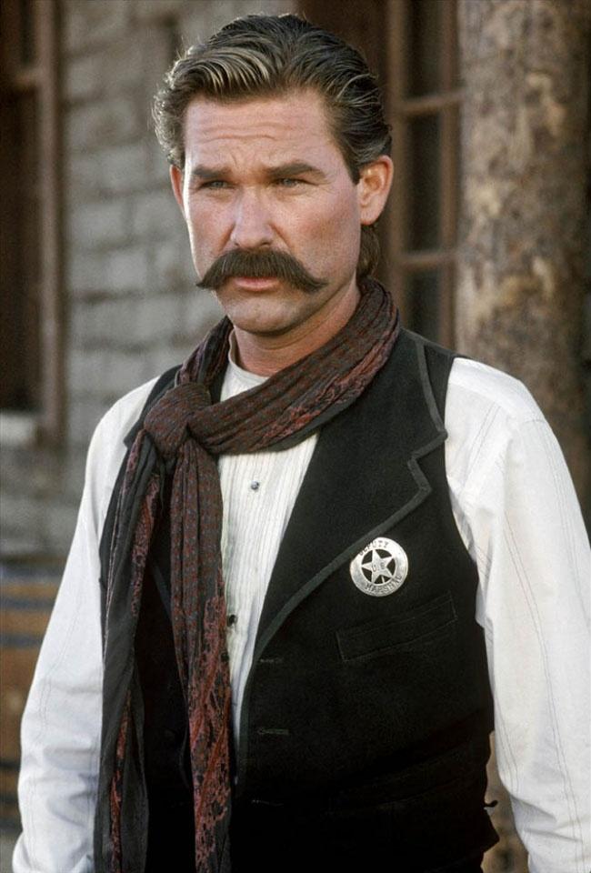 Kurt Russell as Wyatt Earp.
