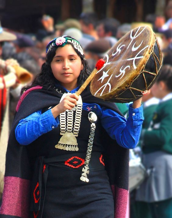 Mapuche woman healer with shaman drum.