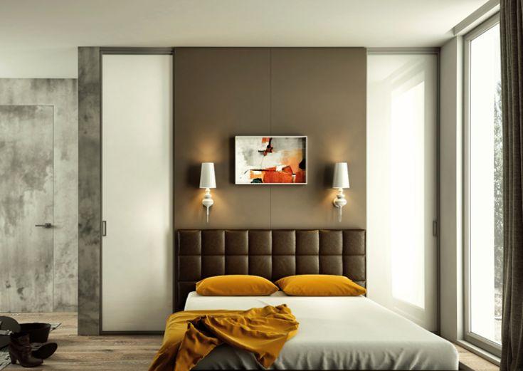 In camera da letto i due punti luce a parete donano eleganza e comfort