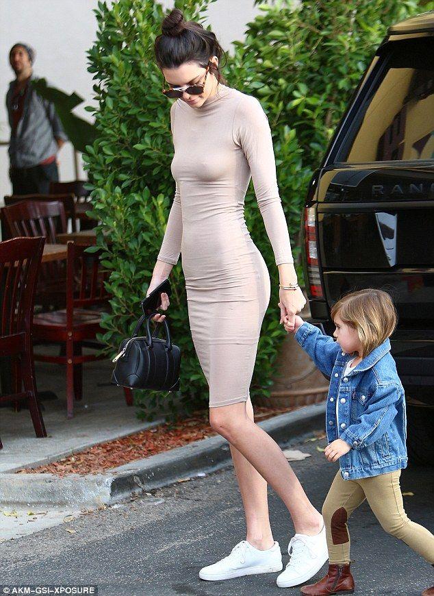 Kendall Jenner dons tight flesh-toned dress as she joins Kourtney Kardashian | Daily Mail Online