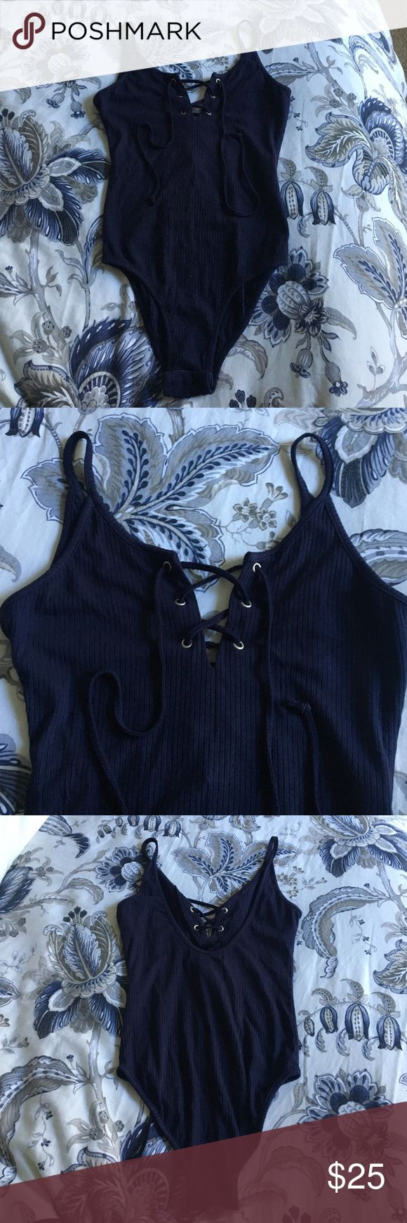 NWT Nordstrom - Glamorous Navy Blue Bodysuit Ribbed knit Bodysuit. Tie up front. Claps at bottom. Scoop back. NWT Nordstrom Tops