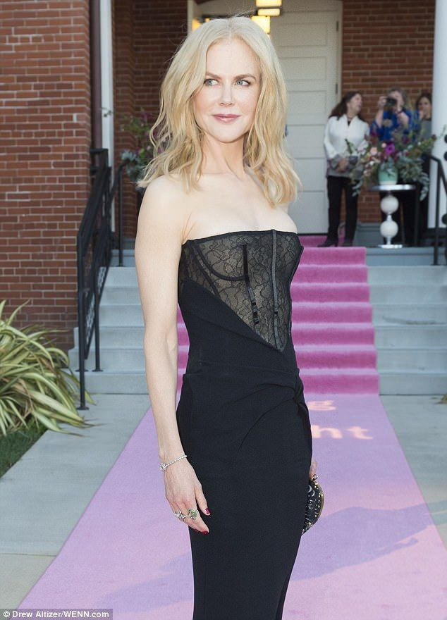 Sultry: The movie star wowed in her stunning strapless frock, complete with a fitted skirt...