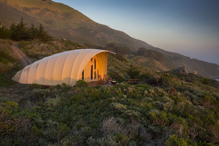 Grand one-of-a-kind tent resembling the shape of a giant cocoon. Secluded on the edge of the resort with your own private deck and outdoor fire pit, you'll experience some of the greatest sunsets in Big Sur. The tent provides over 500 sq ft of indoor living space, a king size bed, luxurious cotton linens and