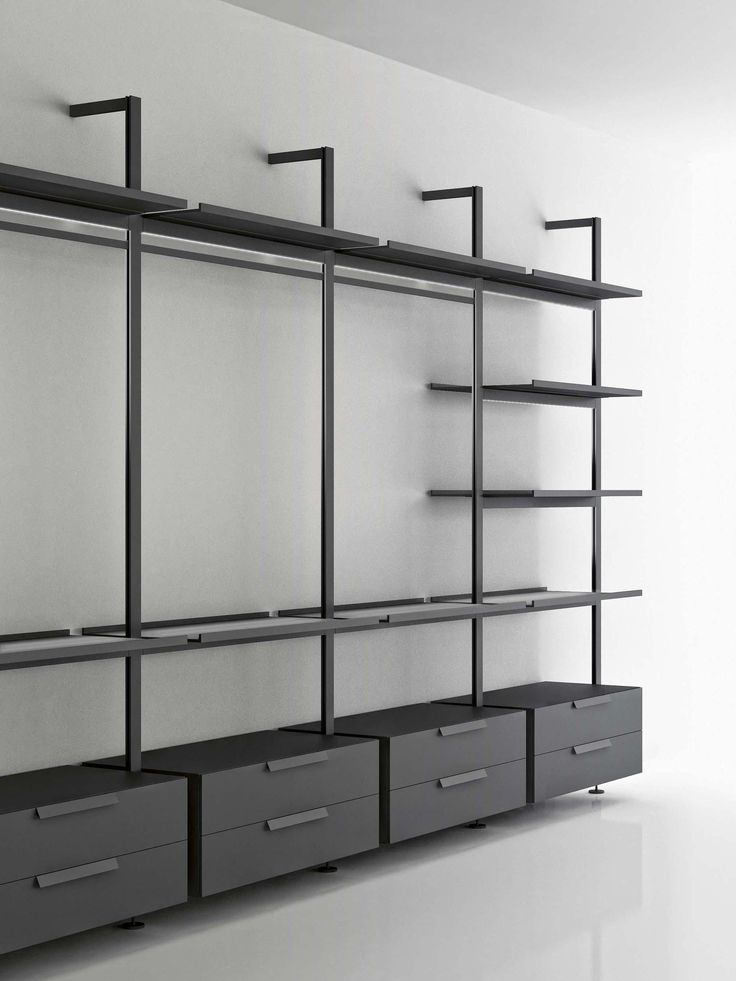 Structure Of Book Case Made Of Aluminium Uprights From Floor To Ceiling Or Wall With Shelves