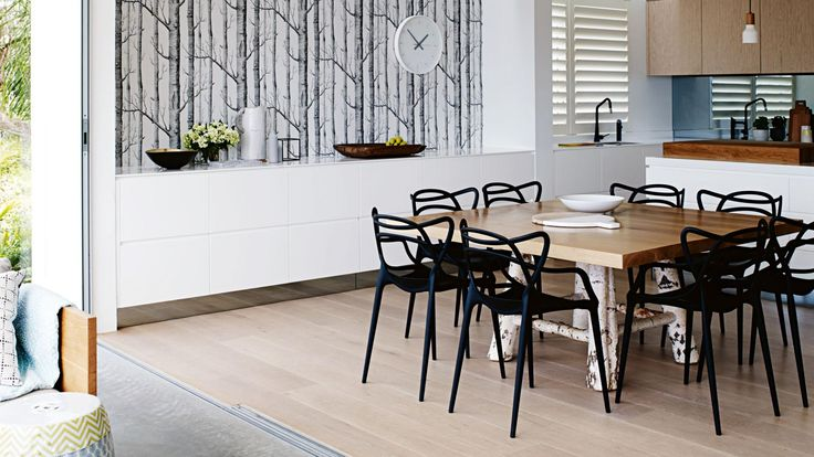 IOT0115HBAYV_05 thrum home pittwater dining room tree wallpaper black chairs white timber floorboards