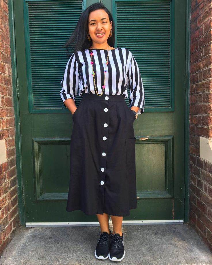 Blogger Megan looks amazing in monochrome wearing a GOOD Clothing Robin dress (R600) and a Selfi Mom skirt (now on sale for R544), with Meraki Jewellery Eldorado earrings (R450) and a Queen Magpie pom pom pendant (R580) for a splash of colour #mandjwomen #monochrome #longstreet #watershedvanda #capetown #lovezabuyza