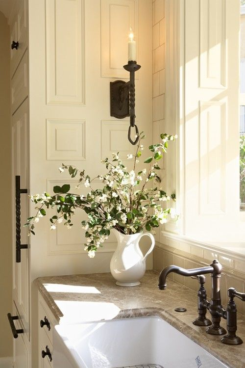 Love the candle sconce, faucet and cabinet pulls. <3