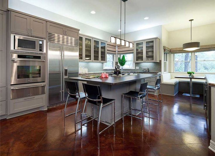 Open Kitchen Design Ideas with stainless furniture and brown ceramic floor