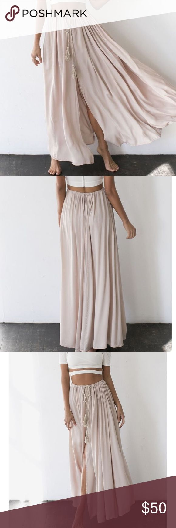 NWT- AGAINST THE TIDES MAXI SKIRT BEIGE-!SOLD OUT! HELLO MOLLY beige maxi skirt. New with tags and still in packaging! Only selling because it was bought for an event, but arrived too late. Sold out online!! Offer up:) HELLO MOLLY Skirts Maxi