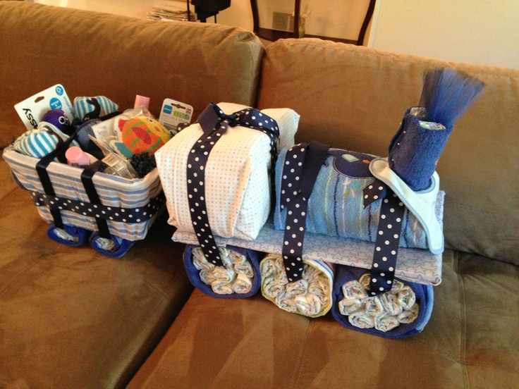 Diaper Train - Whales Theme includes - about 150 diapers, wipes, receiving blankets, bath towels, wash cloths, bath wash, bath lotion, bath toys, pajamas, pacifiers & bibs.