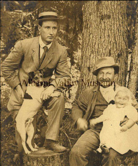 Major R.J. Burde, Leonard Frank with baby Margaret (Nightingale) Burde on knee, 1911.  Photographer Leonard Frank. [Alberni Valley Museum Historic Photograph Collection PN933]