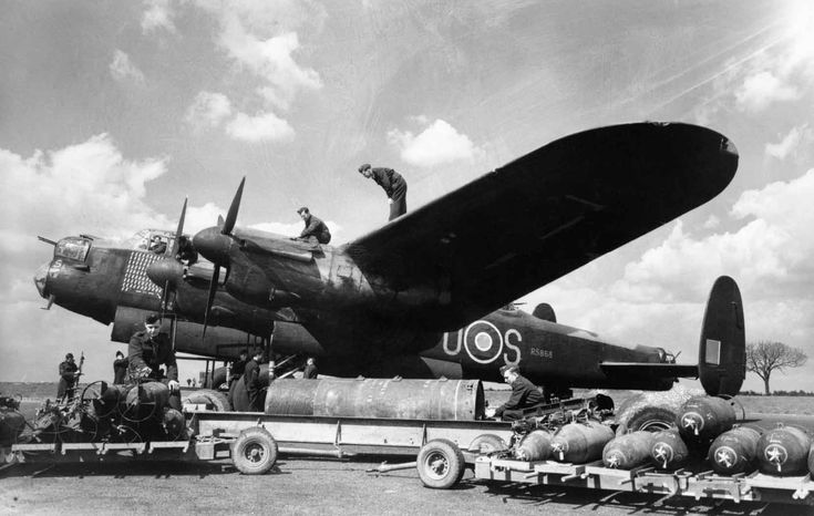RAAF Lancaster bombing up. The engine mounting used for the Merlin on the Lancaster was originally developed for a Merlin powered Bristol Beaufighter, but was used when Manchester's wing was stretched to accommodate an extra engine. On the the remaining flying examples the same exhaust for the Merlin is used as on the Spitfire, but in this wartime photo it is possible to see the anti flash manifold.