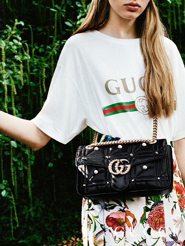 Discover more gifts from the Gucci Garden. The GG Marmont matelassé chain shoulder bag embellished with pearls and studs, and Double G hardware.