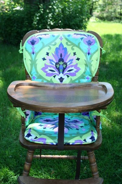 someday when babies come, i want an old wooden highchair. and something bright & cheery on it...just like this.