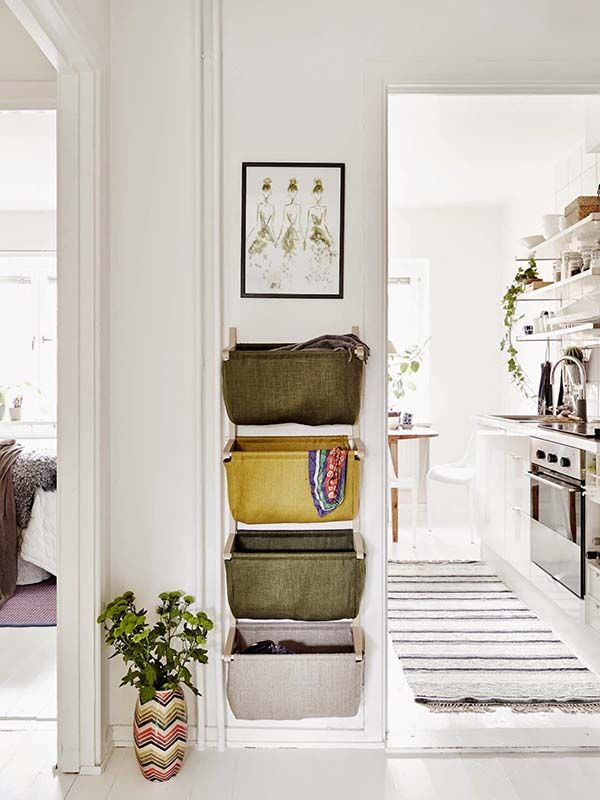 Clever design solution such as wall hanging storage baskets are key to successful Scandinavian design. This helps with organization and helps prevent a small space from getting cluttered.
