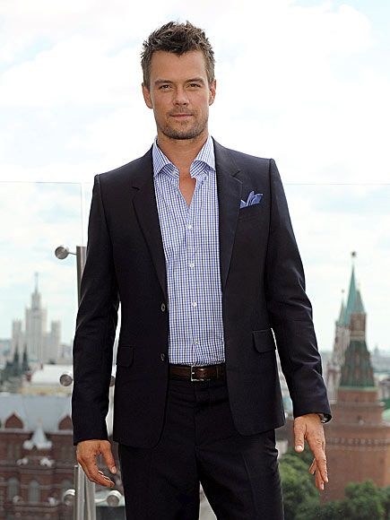 How a man should look... :)  Love the suit sans tie and the scruff!