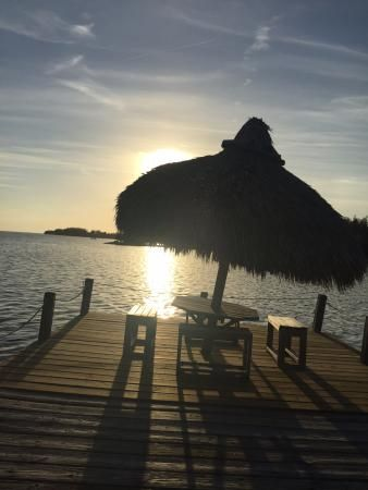 Sunset out on the dock, Seashell Beach Resort | 57612 Overseas Highway, Marathon, FL