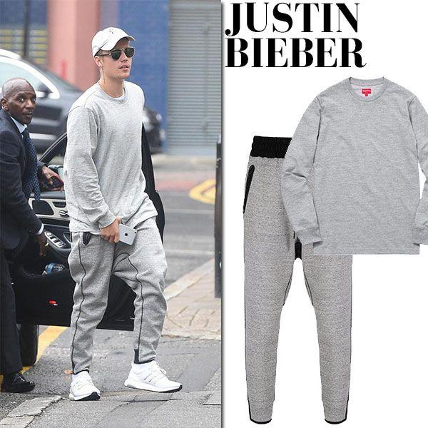 Justin Bieber in grey sweatshirt, grey sweatpants and white sneakers