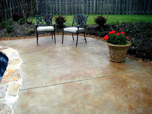 Great use of concrete stains on this decorative pool deck.  Baltz & Sons Concrete Services Somerville, TN