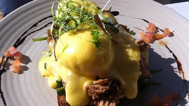 Eggs Benedict are given a welcome twist with pulled pork.