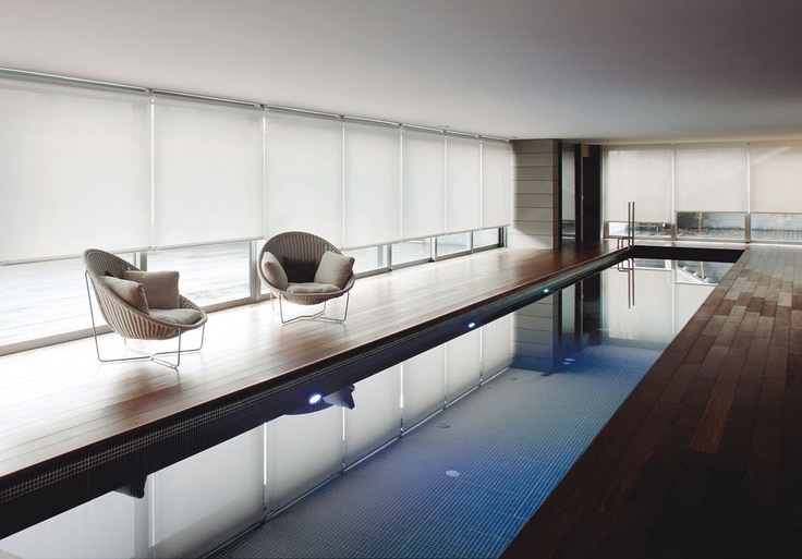 Screen shades by indoor lap pool.