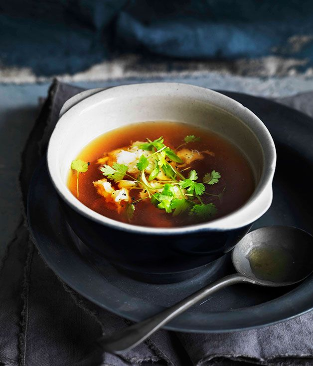 Spanner crab and fennel consommé with soft herbs:2live spanner crabs (750gm each), killed humanely 2 tbspolive oil 1fennel bulb, diced 1½ eachonions and carrots, diced 2 litres (8 cups)fish stock 200 mldry white wine 4vine-ripened tomatoes, coarsely chopped 2garlic cloves ½ tspfennel seeds, dry-roasted 200 gmminced chicken ½celery stalk, diced 4eggwhites To season: Tabasco 2tarragon sprigs To serve:soft herbs, such as chervil and coriander